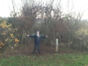 Joel (P7) at the entrance of Fairview PS's Willow tunnel