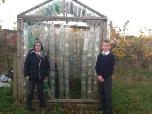 Rory (P7) & Joel (P5) showing off Fairview PS's plastic bottle greenhouse.